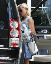 Reese Witherspoon departed her office carrying a chic white Anya Hindmarch bucket bag with a tasseled drawstring.