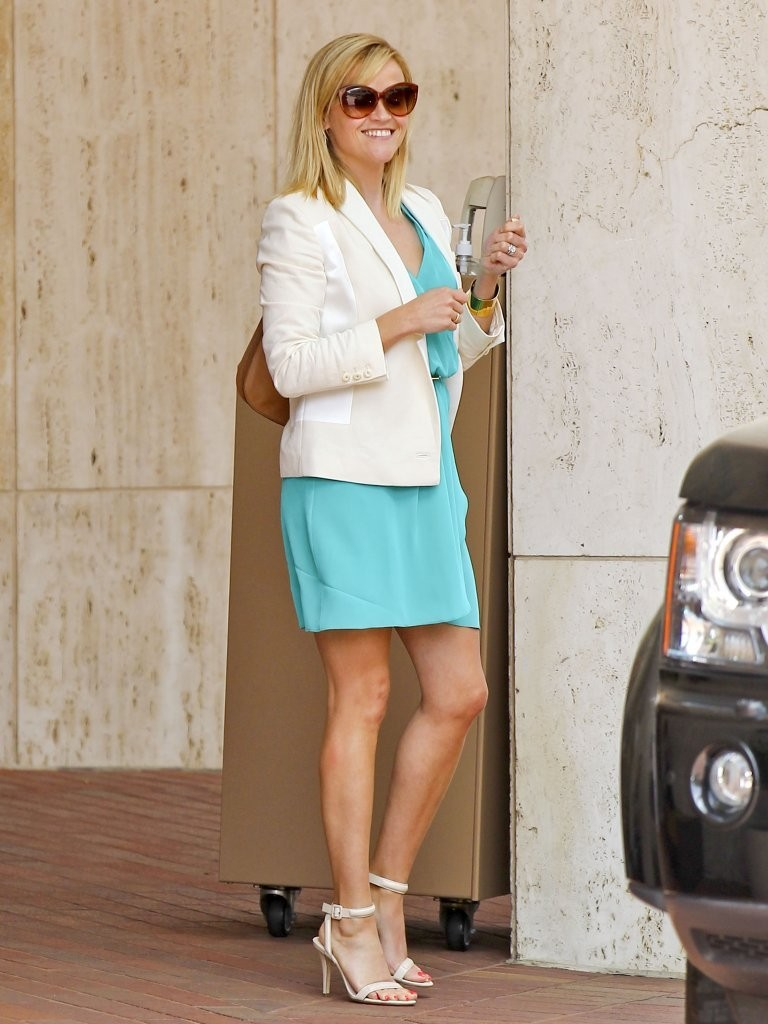 'The Good Lie' actress looks smart and sexy in a turquoise dress while shopping at Neiman Marcus in Beverly Hills, California before meeting her husband on June 12, 2013.
