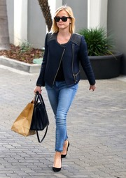 Reese Witherspoon was street-chic in a textured navy leather-panel jacket while attending a meeting in Beverly Hills.