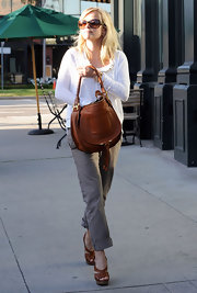 Reese Witherspoon teamed her cuffed khakis with tan cork wedges.