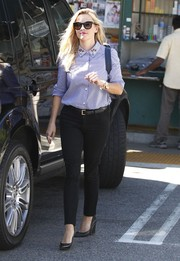 Reese Witherspoon headed out in LA wearing a classic blue button-down with an embellished collar.