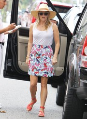 Reese Witherspoon capped off her summery ensemble with red Prada sandals.