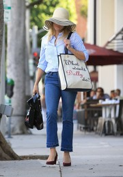 Reese Witherspoon ran errands in cute style wearing cropped bootcut jeans and a floral-embroidered button-down.