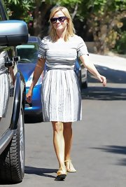 Reese topped off her casual look with a blue-and-white striped dress.
