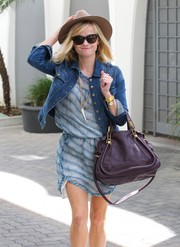 The actress covered up in a casual, medium wash denim jacket with gold snap buttons.