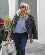 Reese Witherspoon had her hands full with a white leather tote by The Row and another bigger bag while out in Beverly Hills.