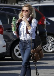 Reese Witherspoon headed out in Brentwood carrying a tan leather shoulder bag.