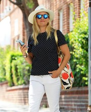 Reese Witherspoon looked cheery with her printed bag and pin-dot blouse combo (both by Draper James) while out and about.