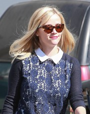 Reese Witherspoon visited a salon looking cute in her tortoiseshell cateye sunnies and lace-front sweater.