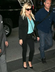 Reese Witherspoon was seen outside her New York City hotel wearing a black blazer with skinny jeans and a Tiffany-blue blouse.