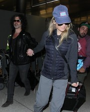 Renee Zellweger tried to go incognito at LAX with a USO cap and a pair of shades.