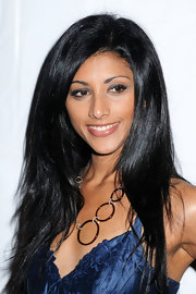 Reshma Shetty styled her luxurious locks in a layered cut for the Tracy Reese fashion show.
