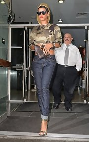 Rihanna stepped out in NYC sporting this brown camo-print crop top and matching sandals.