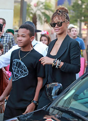 Rihanna looked fantastic with her hair in a simple bun with long wavy bangs at The Grove in Los Angeles.
