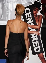Rihanna has her first initial tattooed on her left shoulder.