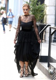 Rita Ora brought a high dose of glamour to the streets of New York City with this black lace and chiffon dress by Antonio Berardi.