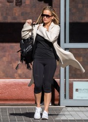 Rita Ora headed to the gym wearing black capri leggings and a matching tank top.