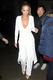 Rita Ora flashed some cleavage in a deep-V white wrap dress by Bec & Bridge while out in New York City.