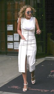 Rita Ora kept it relaxed yet chic in a white zip-front midi dress layered over a tank top while out in New York City.