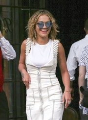 Rita Ora accessorized with ultra-modern blue sunglasses while out in New York City.