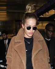 Rita Ora was spotted at LAX sporting a pair of Ray-Bans and a fluffy coat.