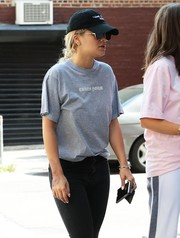 Rita Ora kept a low profile with a black baseball cap and a pair of shades while out and about in New York City.