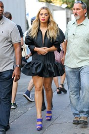 Rita Ora was spotted out in New York City wearing a frilly ruffle LBD by Ellery.