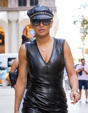 Rita Ora got majorly edgy with this studded newsboy cap and leather LBD combo for a stroll in New York City.