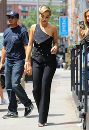 Rita Ora looked very fashion-forward in a black Antonio Berardi one-shoulder jumpsuit, featuring a crossover bodice and silver buttons, while out in New York City.