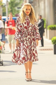 Rita Ora covered up her figure in a loose-fitting red and white print dress by Ellery for a day out in New York City.