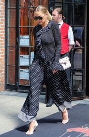 Rita Ora styled her jumpsuit with white ankle-strap sandals by Tom Ford.