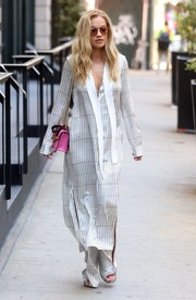 Rita Ora looked exotic in a striped tie-neck dress and matching pants by Hellessy while out in New York City.