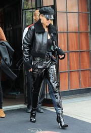 Rita Ora got majorly tough in a black leather jacket with a fur collar and cuffs for a day out in New York City.
