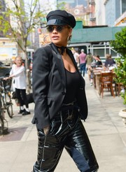 Rita Ora topped off her all-black look with a newsboy cap.