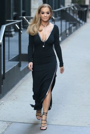 Rita Ora continued her impressive sartorial run on the streets of New York City with this black Dsquared2 dress featuring a deep-V neckline, a high side slit, and silver trim.
