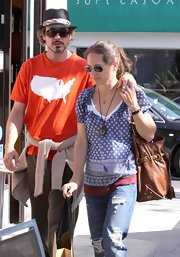 Susan Downey's comfy shopping ensemble consisted of a print peasant blouse and ripped jeans.