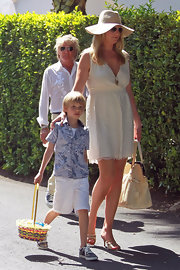 Penny Lancaster attended an Easter party with her family wearing a white mini-dress.
