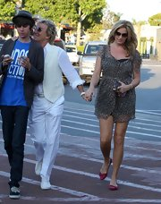 Penny Lancaster was strolling with family in Malibu wearing her bow-detailed flat shoes.