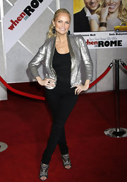 Kristin paired her metallic blazer with dazzling cutout booties embellished with bronze-hued sequins.