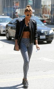 Jasmine Tookes went shopping in LA rocking gray leggings and a black sports bra.