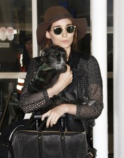 Rooney Mara kept a low profile with a floppy hat and a pair of sunnies while making her way through LAX.