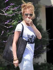 Rosanna Arquette was out and about in Brentwood while having lunch with a friend. She carried a textured tote bag while donning a casual outfit.