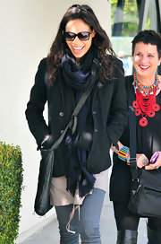Rosario stays warm and stylish in a thick navy ombre scarf out in Santa Monica.
