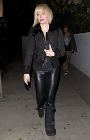 Rose McGowan chose a rocker-inspired look with this black bomber with a fur collar.