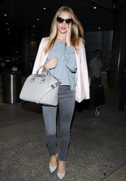 Rosie Huntington-Whiteley smartened her sweater/jeans combo with a pale-pink blazer by Stella McCartney.