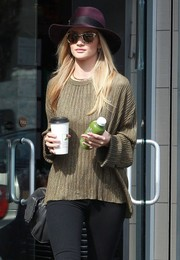 Rosie Huntington-Whiteley tried to go incognito in Carrera by Jimmy Choo Panther wayfarers and a purple hat as she grabbed some coffee.