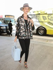 Rosie Huntington-Whiteley injected some glamour with a pair of embellished sandals by Tabitha Simmons.