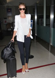 Rosie Huntington-Whiteley paired Paige skinny jeans with a Chloe embroidered blazer for her travel look.