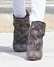 Rosie Huntington-Whiteley showed her edgy side just a bit with these cowboy-inspired ankle booties.