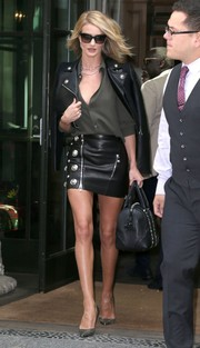 Rosie Huntington Whiteley was a head turner on the streets of New York City in a black Versus Versace leather mini and a matching jacket.